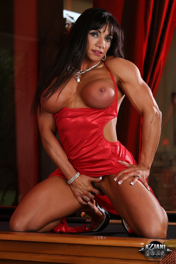 image Milf flexes muscles while riding cock